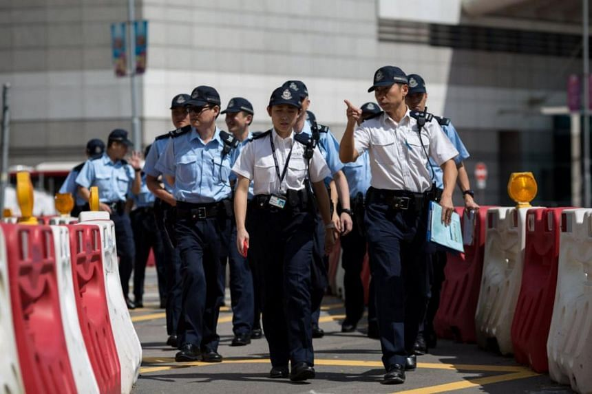 Police patrol near Bauhinia Square in Hong Kong on June 28, 2017.