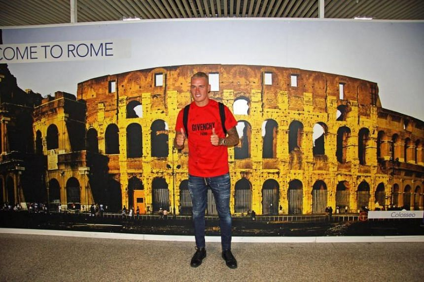 Feyenoord defender Rick Karsdorp posing for photographers at Fiumicino Airport in Rome, Italy ahead of his medical with Italian Serie A side AS Roma.