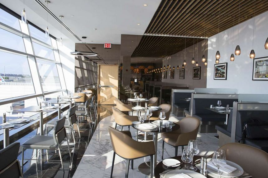 The Flagship First Dining outlet makes full use of the view with floor to ceiling glass walls. PHOTO: BLOOMBERG