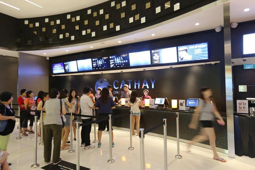 People at the ticket counter at Cathay Jem cinema.