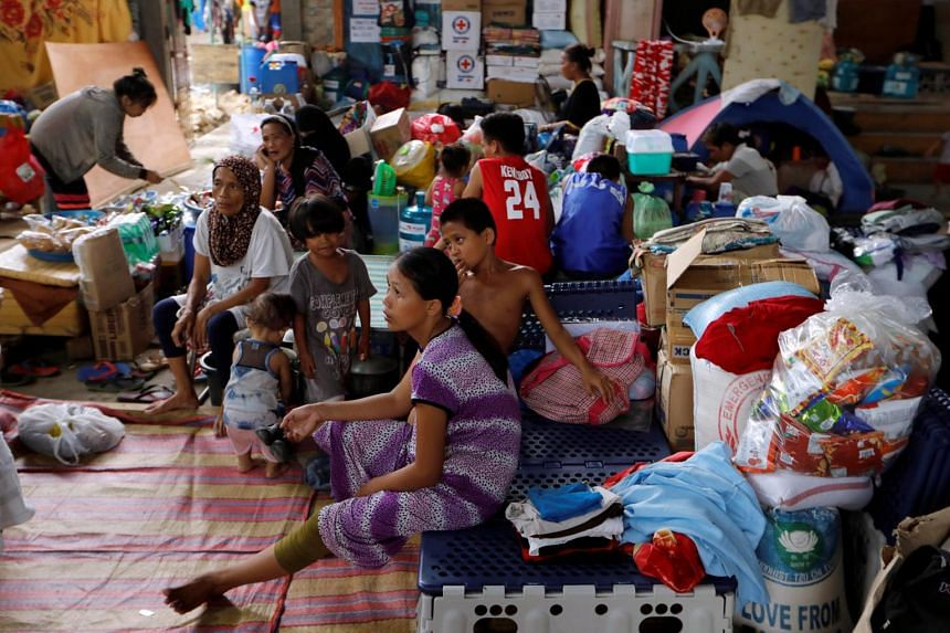 Evacuated residents resting at an evacuation centre in Iligan, while government forces fight insurgents from the Maute group in Marawi, Philippines, on June 27, 2017.