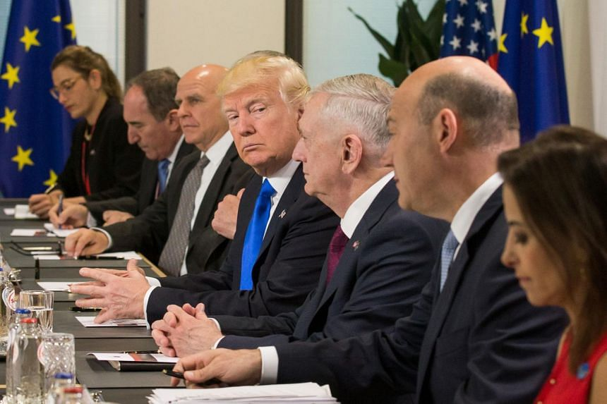 US President Donald Trump (centre) and US defence minister, James Mattis (third from right), during a Nato meeting at the European Union Headquarters in Brussels, on May 25, 2017.