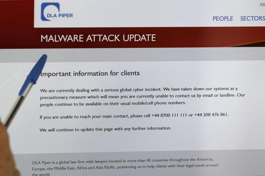 A screen displays the website of the global law firm DLA Piper showing a message advising readers that their computer systems have been taken down as a precautionary measure, on June 28, 2017.