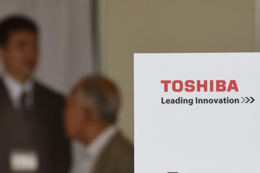 A shareholder of Toshiba Corp arrives at a meeting in Chiba, on June 28, 2017.
