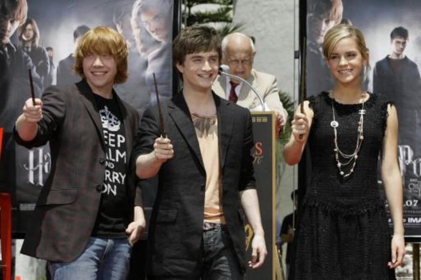 The main stars of the Harry Potter films holding their magic wands during a hand and foot print ceremony in the forecourt of Graumans Chinese Theatre in the Hollywood section of Los Angeles.