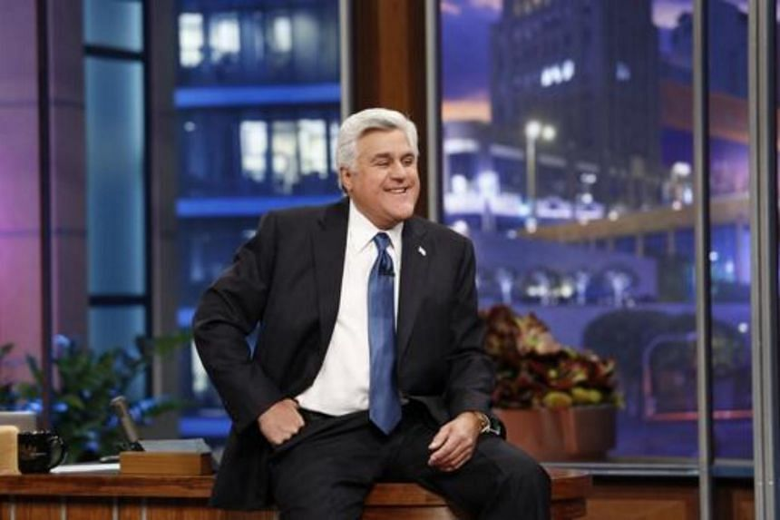 Jay Leno sits on his desk on his final night hosting The Tonight Show with Jay Leno in Burbank.