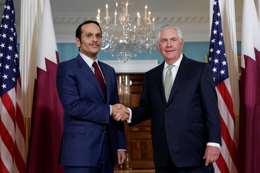 US Secretary of State Rex Tillerson (right) shaking hands with with Qatari Foreign Minister Sheikh Mohammed bin Abdulrahman Al Thani (left) before their meeting at the State Department in Washington, on June 27, 2017.