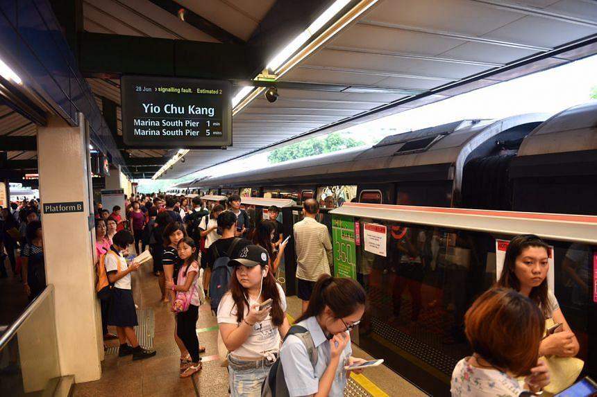 Commuters waiting at Khatib MRT station platform. ST PHOTO: JOYCE FANG