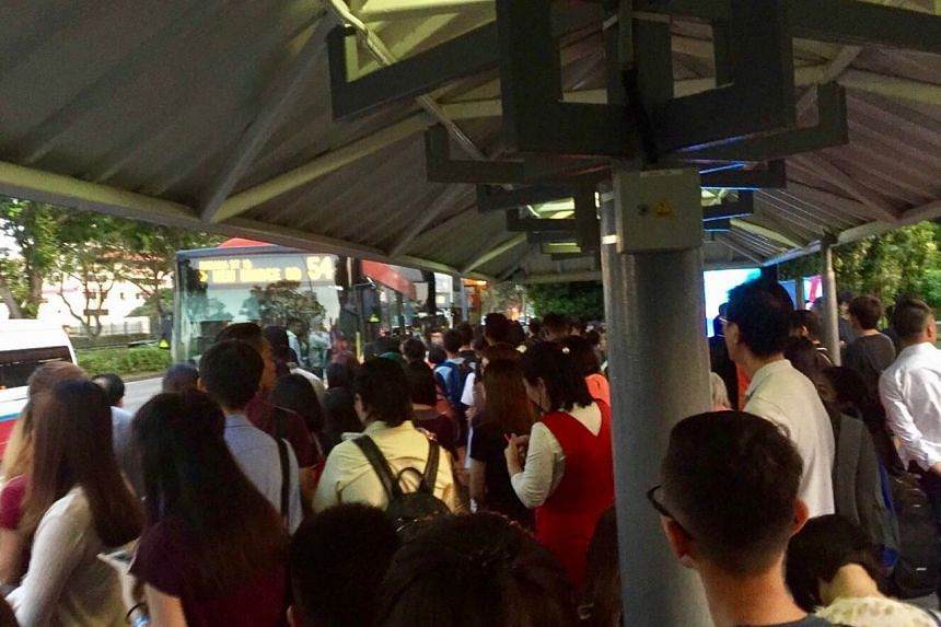 The bus stop opposite Bishan MRT was packed with commuters who were affected by the train disruption.