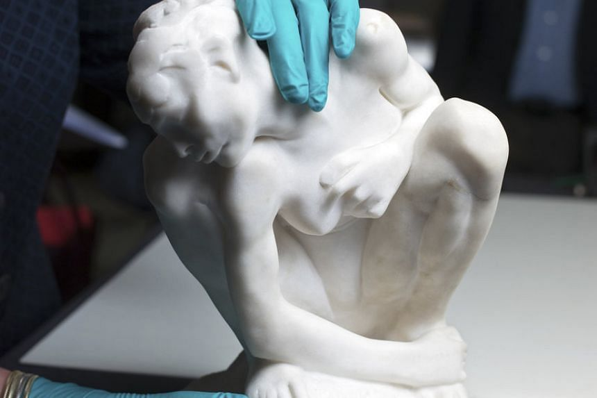 A crouching woman in marble by Rodin, circa 1882, from a trove of artworks found in the homes of Cornelius Gurlitt, many of them suspected of having been looted by the Nazis. PHOTO: NYT