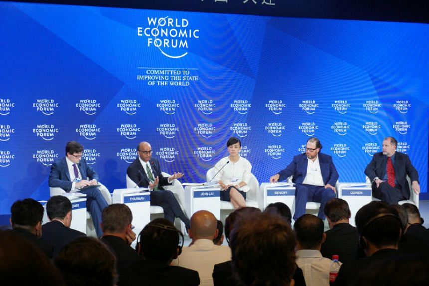DPM Tharman Shanmugaratnam (second from left) participating in a World Economic Forum panel discussion on inclusive growth on Wednesday (June 28) in Dalian, China.