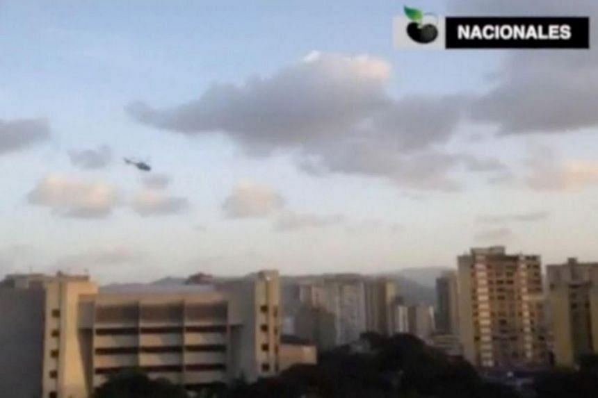 A police helicopter flies over Venezuela's Supreme Court building in Caracas on June 27, 2017.
