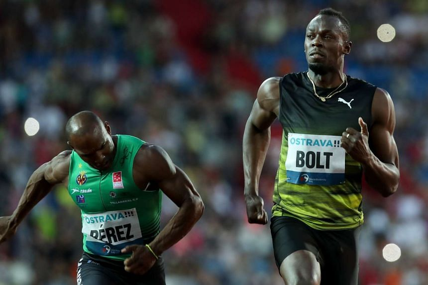 Jamaican Usain Bolt (right) in action during the men's 100m.