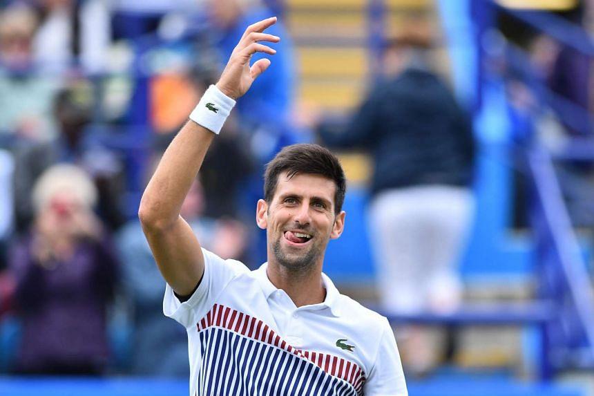 Djokovic celebrates his win.