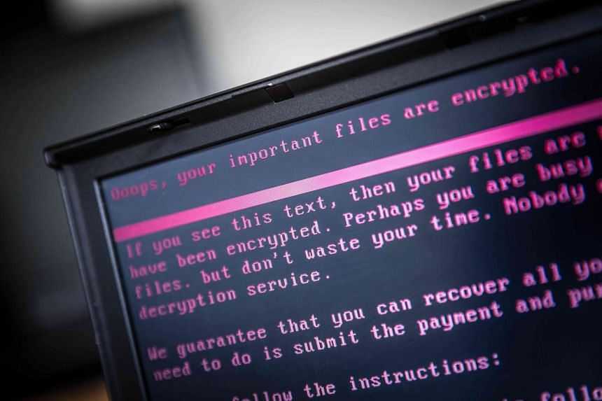 A laptop displays a message after being infected by a ransomware as part of a worldwide cyberattack in Geldrop, on June 27, 2017.