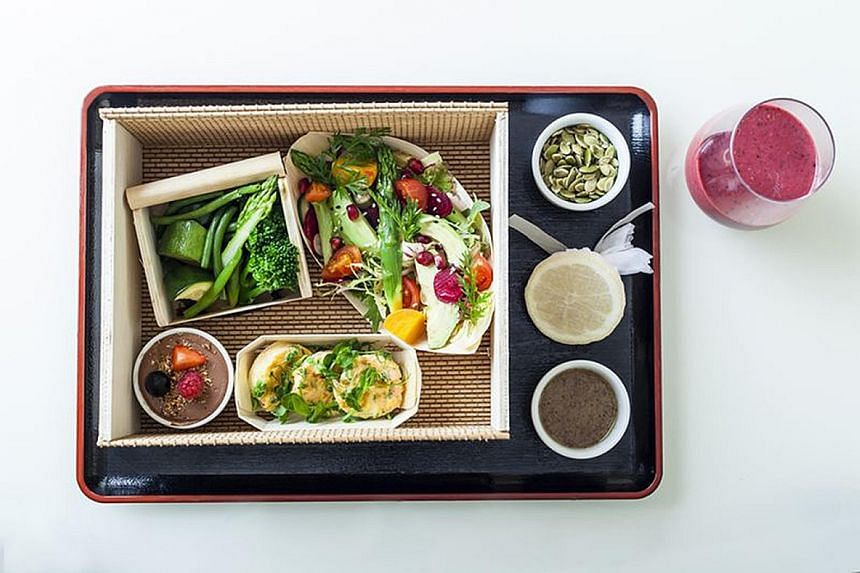 Anantara Siam's room service includes Nam Prig Long Rua (above), a chilli-spiked stir-fry dish, and The Dorchester serves healthy bentos (left). Breakfast is available almost around the clock at Four Seasons Hotel New York Downtown.