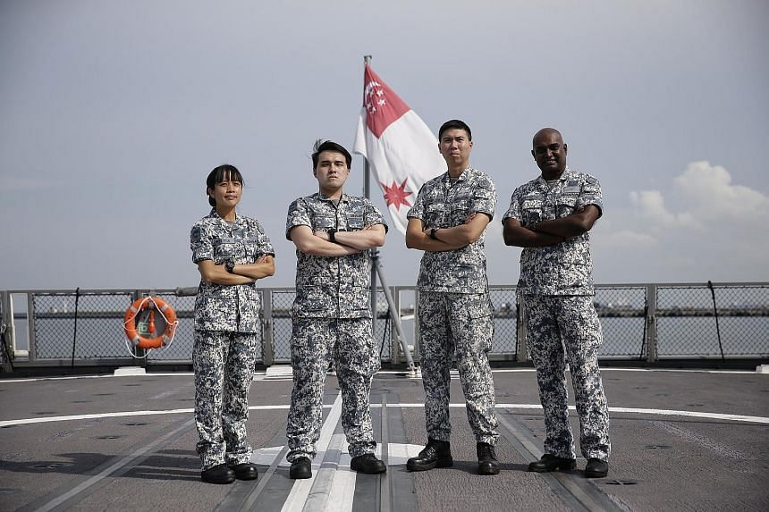 From left: ME2 Winnie Lai, CFC (NS) Jason Koh, Commanding Officer LTC Edwin Chen and ME3 D. Vijayan (Coxswain) are part of the RSS Steadfast crew, which won the Best Fleet Unit award. LTC Ng Kiang Chuan (red beret) with some commandos taking part in