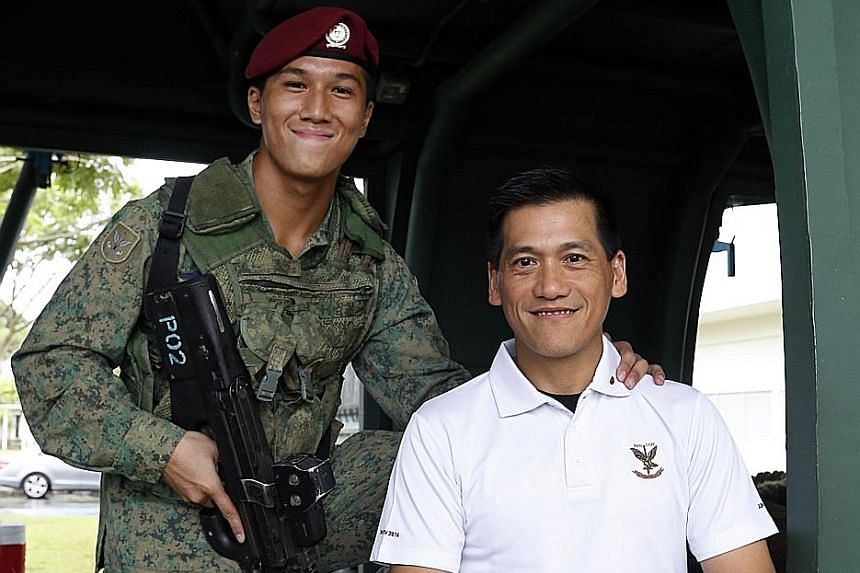 """Cpl Anders Seah of the 1st Commando Battalion with his father, Seah Yee Choon. The elder Seah was part of the commando unit that won the Best Combat Unit in 1988. """"Before every mission, my father would give me a call and even recorded a video to offe"""