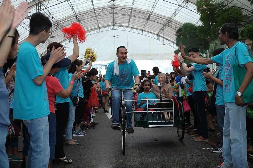 Mr Sherman Kwek, deputy CEO of City Developments, riding a trishaw carrying Sister Florence Wong and Gracelyn Ng during the fund-raiser. The June 18 event raised more than $76,000 for Assisi Hospice.