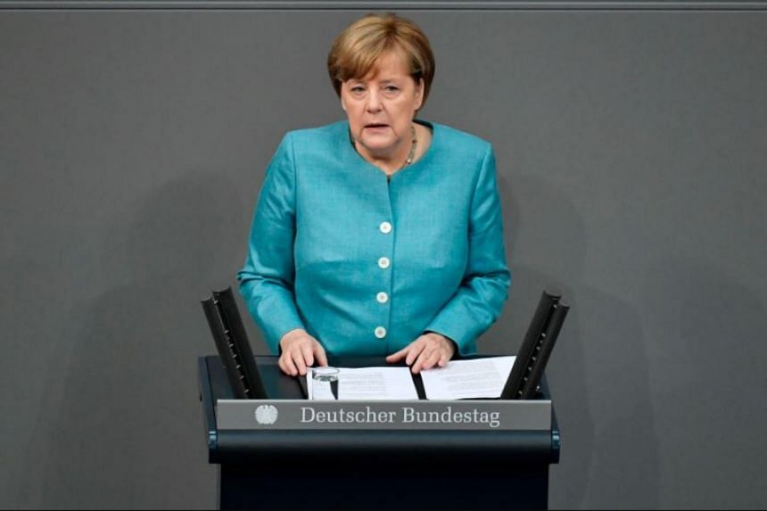 German Chancellor Angela Merkel delivers a speech at the Bundestag, lower house of Parliament, on June 29, 2017 in Berlin, ahead of the July 7-8 G20 summit.