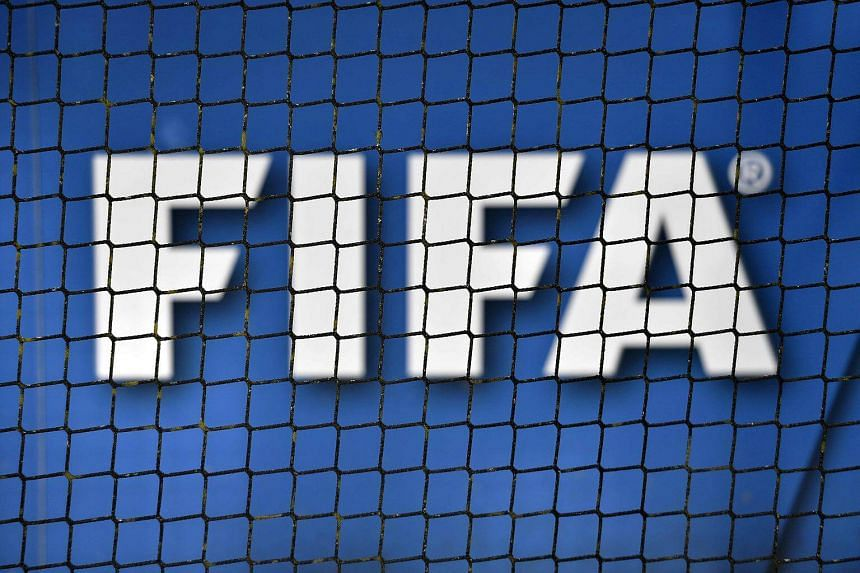 The logo of Fifa through a net at the world football's governing body headquarters in Zurich.