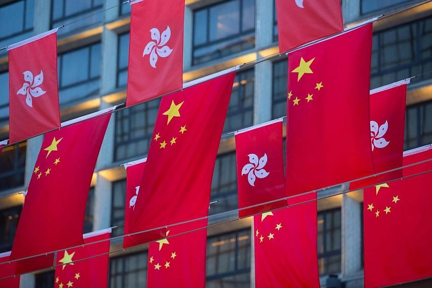 National flags of China and Hong Kong hang in a display ahead of Chinese President Xi Jinping's arrival in Hong Kong.