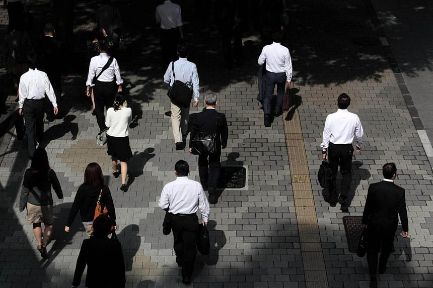 Morning commuters make their way to work in Tokyo.