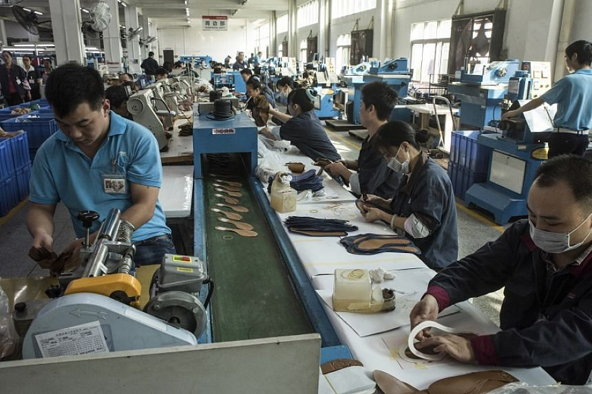 Workers on an assembly line at a factory which makes shoes for Ivanka Trump and other designers.