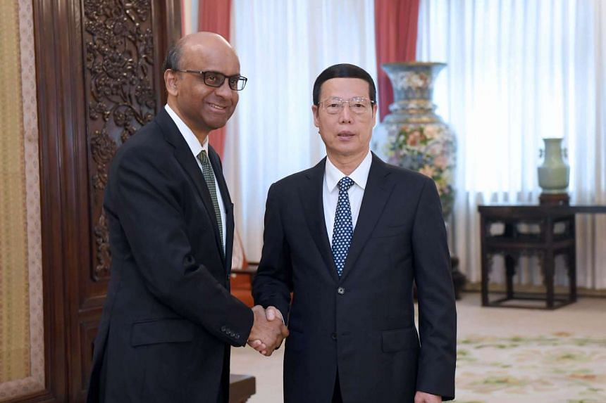Singapore Deputy Prime Minister Tharman Shanmugaratnam shaking hands with Chinese Vice-Premier Zhang Gaoli in Beijing on June 29, 2017.