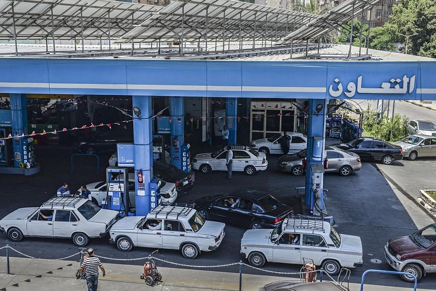 Cars queue at a gas station as they try to refuel in Cairo, Egypt, June 29, 2017.