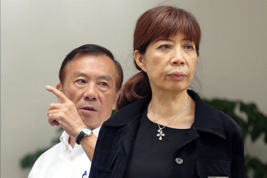 Siblings Henry and Judy Teo leaving the State Courts on June 29, 2017.