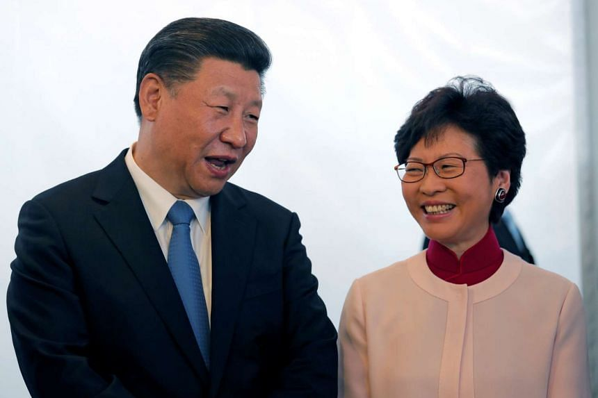 Chinese president Xi Jinping speaking with Hong Kong Chief Executive-elect Carrie Lam during a visit to West Kowloon, Hong Kong on June 29, 2017.