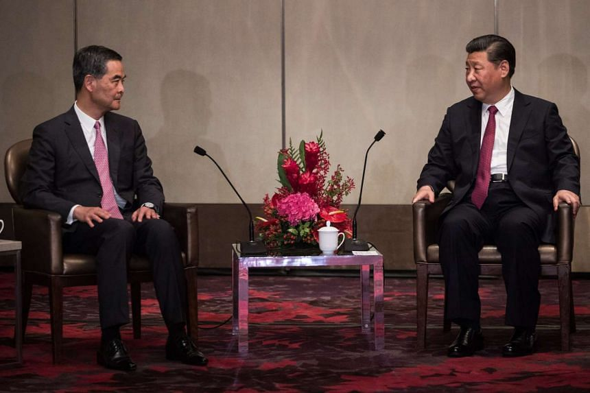 China's President Xi Jinping (right) speaking with Hong Kong Chief Executive Leung Chun-ying during a meeting at a hotel in Hong Kong on June 29, 2017.