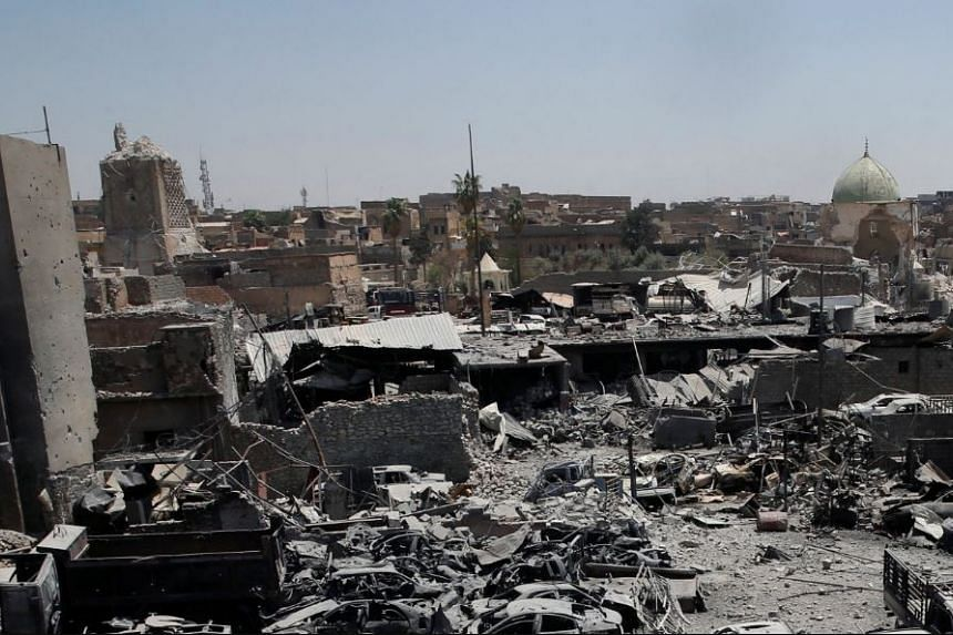 A destroyed al-Hadba minaret at Grand al-Nuri Mosque is seen with the ruins of the mosque and other destroyed houses from the Iraqi forces positions at the Old City in Mosul, Iraq June 27, 2017.