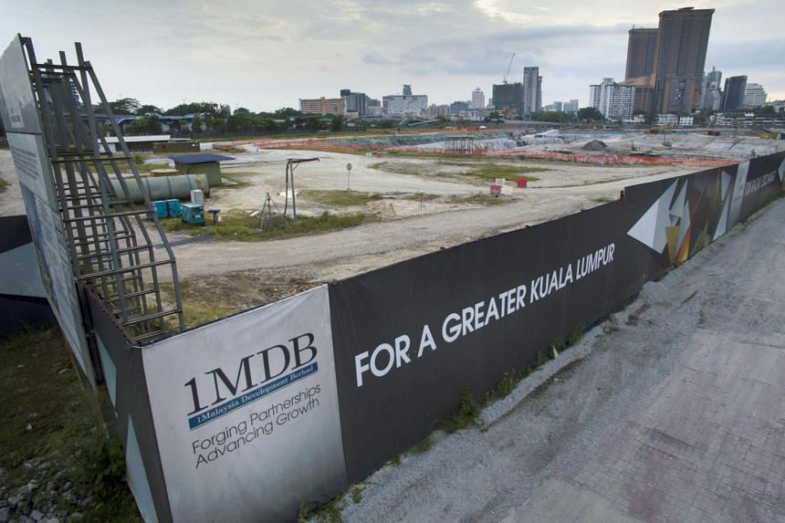 A signage of 1 Malaysia Development Berhad is displayed at the site of the Tun Razak Exchange project in Kuala Lumpur.