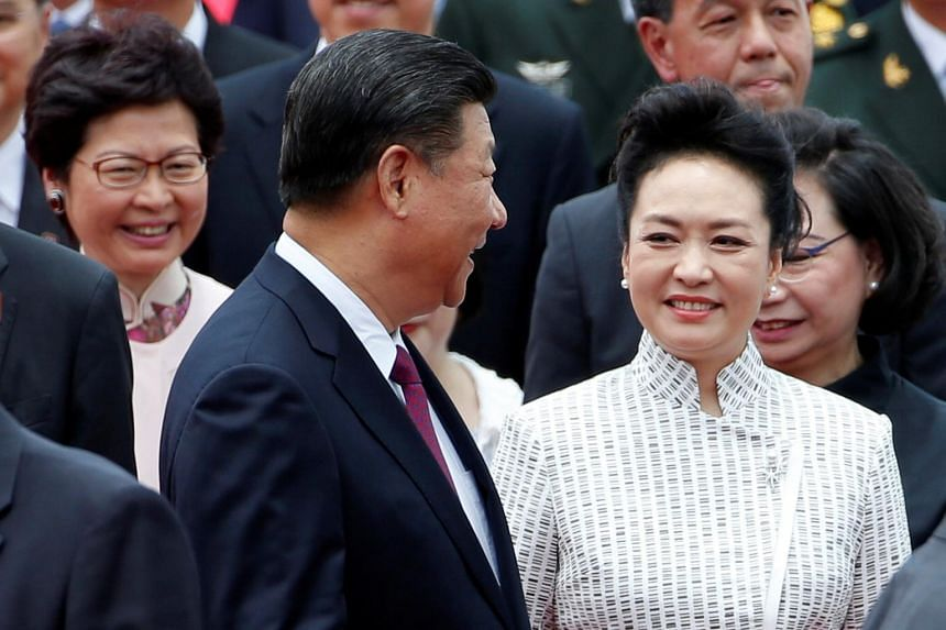 China's First Lady Peng Liyuan looks at Chinese President Xi Jinping upon their arrival, in front of Chief Executive-elect Carrie Lam (back left), in Hong Kong.