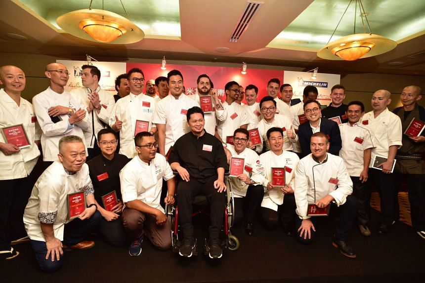Michelin one-star recipients posing on stage for a group photo on June 29, 2017.