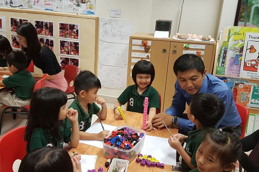 Minister for Social and Family Development Tan Chuan-Jin visiting a Small Wonder pre-school in Yishun, one of more than 400 pre-schools taking part in the Smart Solutions initiative.