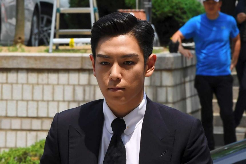 South Korean pop star T.O.P arrives at a court on June 29 to attend his trial on charges of smoking marijuana. The rapper from K-pop boy band Big Bang was accused of smoking marijuana on four occasions in his home in Seoul last October and has partia