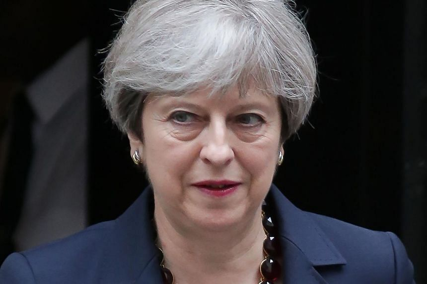 Britain's Prime Minister Theresa May leaves No 10 Downing St for Westminster in central London on June 28, 2017.