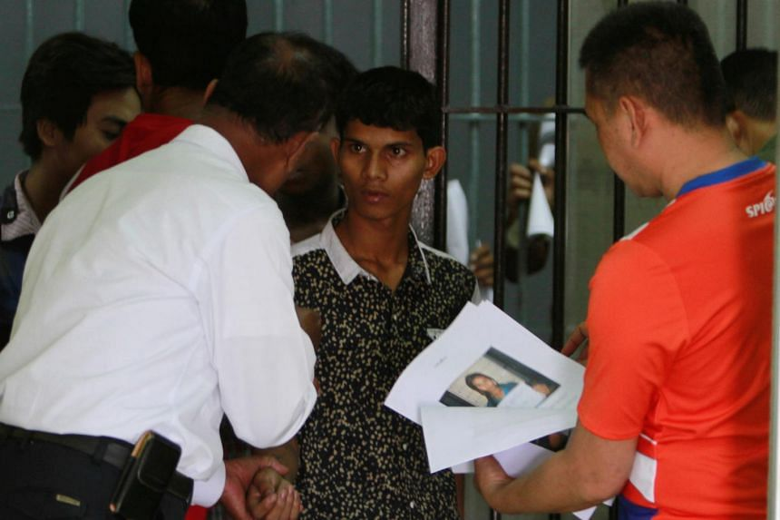An illegal migrant from Myanmar is pictured at Tha Sala police station in Nakorn Si Thammarat province in Thailand on May 6, 2017.