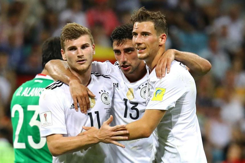 Germany's Timo Werner celebrates scoring their third goal with Lars Stindl and Leon Goretzka.