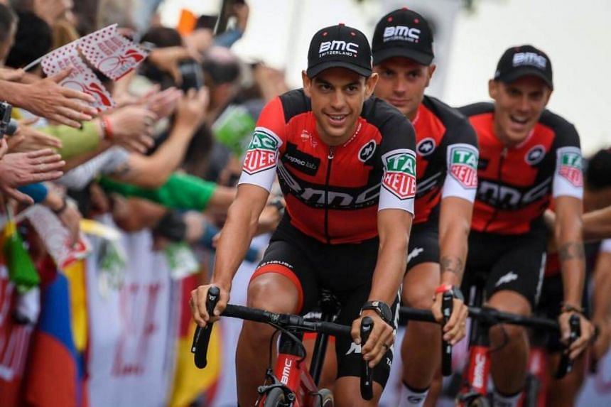 Australia's Richie Porte (left) and his teammates parade during the team presentation ceremony in Dusseldorf, Germany, on June 29, 2017, two days before the start of the 104th edition of the Tour de France cycling race.