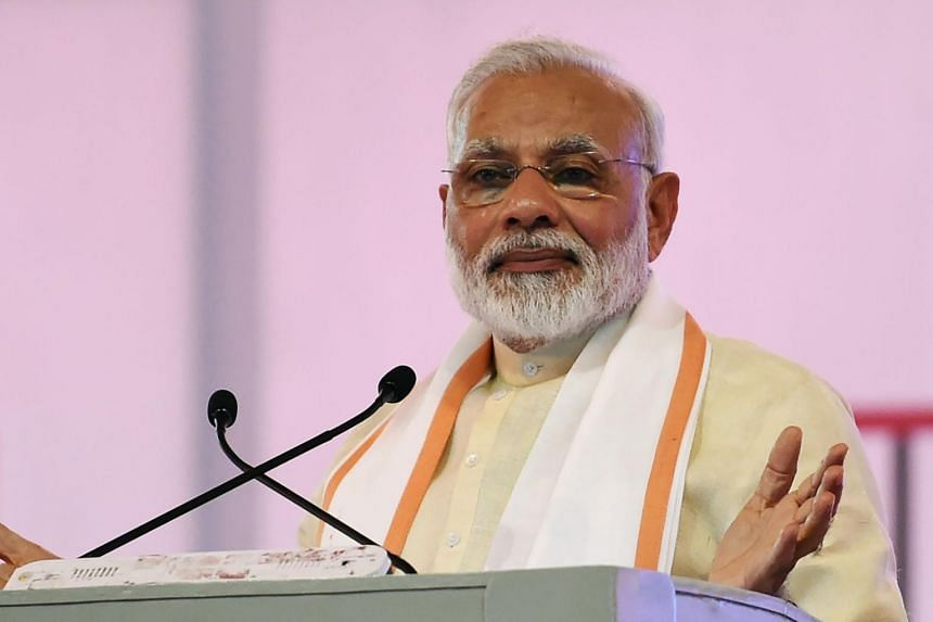 Indian Prime Minister Narendra Modi gives a speech in Ahmedabad on June 29, 2017.