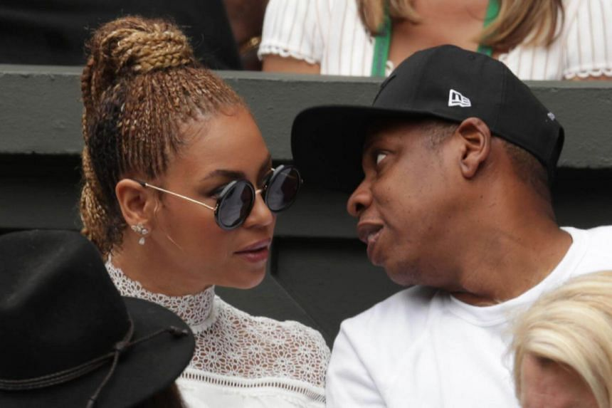 US singer Beyonce (left) and her husband US rapper Jay Z sitting in the players box to watch Serena Williams play against Germany's Angelique Kerber during the women's singles final of the 2016 Wimbledon Championships in Wimbledon, on July 9, 2016.
