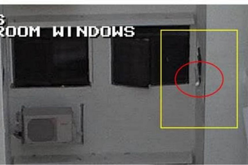 Image of the used sanitary pad (circled) thrown out of the window.