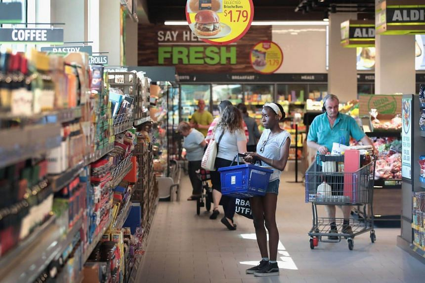 Customers shop at an Aldi grocery store in Chicago, Illinois  on June 12, 2017.