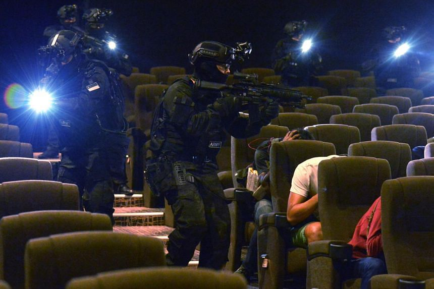 The terrorists held hostages in a Golden Village cinema hall in Tampines Mall during a media preview of the counter- terrorism exercise, held on Oct 17, 2016.