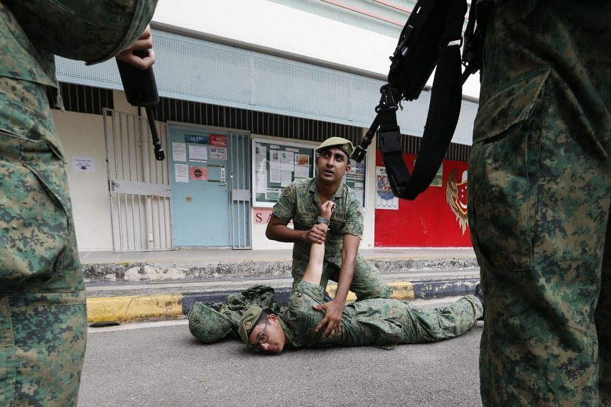 Soldiers from 4th Battalion, Singapore Infantry Regiment, going through refresher training in search and arrest skills at Lim Chu Kang Camp I, in preparation for their deployment to key locations islandwide for joint patrols with the police on Oct 17