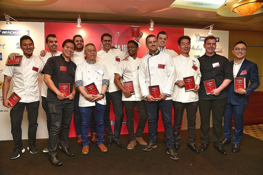 Chef Luke Armstrong (fourth from right) from The Kitchen at Bacchanalia, which retained its one star, with chefs and representatives from the new one-Michelin-starred restaurants (from left) Sun Kim of Meta, Sam Aisbett of Whitegrass, Han Liguang of